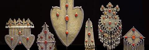 Joel Cooner\'s arrangement of tribal jewelry.